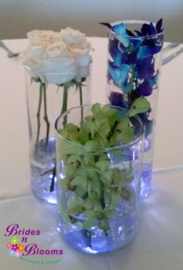 3 cylinder Design with Green & Blue Orchids & White Roses