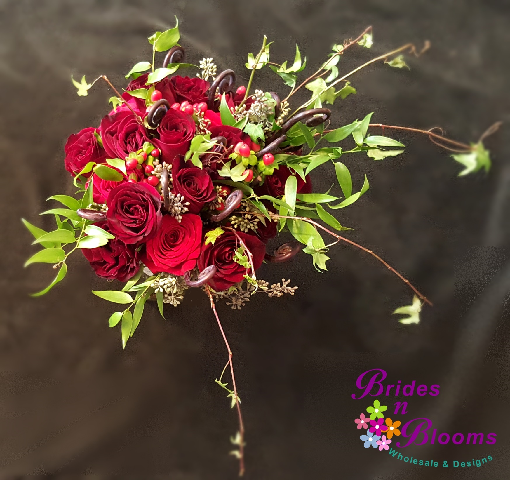 Ivy & Seeded Eucalyptus greenery with Red Roses, Hypericum Berry and Fiddle Fern
