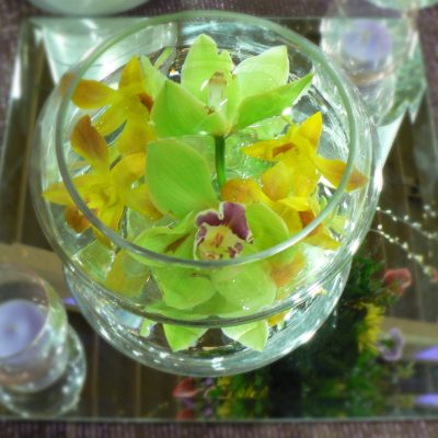 Round Centerpiece of Submerged Cymbidian Orchids in Green & Yellow  Dendrobium Orchids