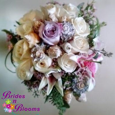 Brides N Blooms Designs Shell Bouquet bouquet