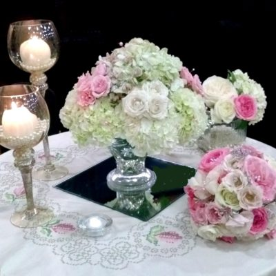 Vintage pink & white table centerpieces with hydrangea & Roses