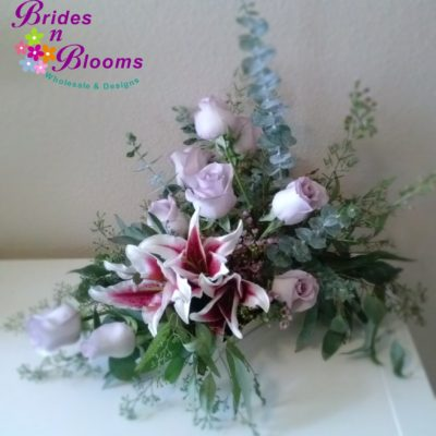 Brides N Blooms Designs lily & rose sweetheart table design