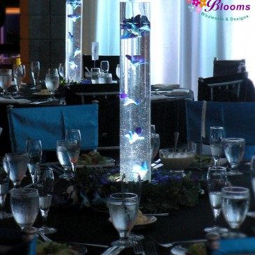 Cylinders with suspended Orchids, Wreath of Flowers with lit base