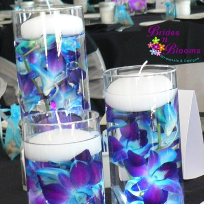 Brides N Blooms, submerged Orchid Centerpiece with Candles