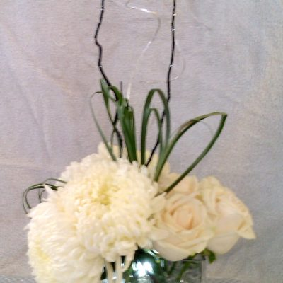 White Mums & Roses with Lily Grass and Curly Willow lit with a submersible light
