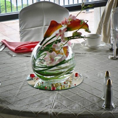 Bubble Bowl Centerpiece Design of Mums and Orchids