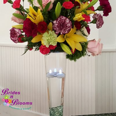 Tall Colorful Flower Arrangement on Pilsner