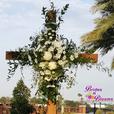 Flowers on wooden cross