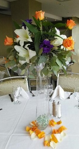 tall orange, purple and white centerpiece