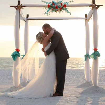 Beach Wedding bride, groom, arch